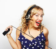 Young happy woman with headphones listening music Royalty Free Stock Images