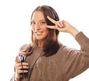 Young happy woman with headphones listening music Stock Photography