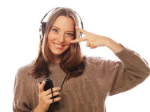 Young happy woman with headphones listening music Royalty Free Stock Photography