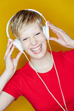 Young happy woman with headphones Royalty Free Stock Image