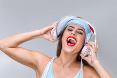 Young happy woman with headphones Stock Image