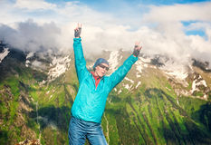 Young happy woman hiker on the top of mountain Royalty Free Stock Images