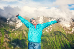 Young happy woman hiker on the top of mountain Royalty Free Stock Image
