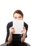 Young happy woman hinding her face behind notebook Royalty Free Stock Images