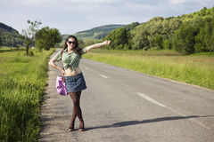 Young happy woman hitchhiking Stock Photography