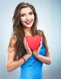 Young happy woman hold Love symbol red heart. Isolated on studi Stock Photography