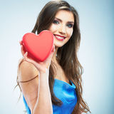 Young happy woman hold Love symbol red heart. Isolated on studi Stock Photos