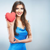 Young happy woman hold Love symbol red heart. Isolated on studi Royalty Free Stock Image