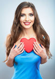 Young happy woman hold Love symbol red heart. Isolated on studi Royalty Free Stock Images