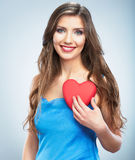 Young happy woman hold Love symbol red heart.  on studi Stock Photos