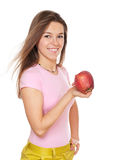 Young happy woman holding apple Stock Photos