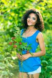 Young happy woman holding big bouquet of spring flowers outdoors Stock Photography