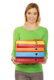 Young happy  woman holding binders Royalty Free Stock Photos