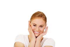 Young happy woman holding both hands on cheeks Stock Photography