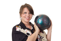Young happy woman holding bowling ball. Young happy woman holding a bowling ball and wearing a bowling shirt; isolated on a white background Royalty Free Stock Image