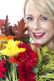 Young Happy Woman Holding a Bunch of Flowers Stock Image