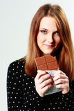 Young happy woman holding chocolate Stock Photography