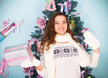 Young happy woman holding Christmas present Stock Photos