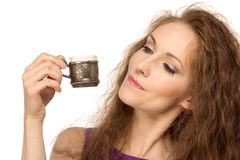 Young happy woman holding a coffee cup isolated Stock Photography
