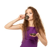 Young happy woman holding a coffee cup isolated Royalty Free Stock Photos