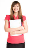 Young happy woman holding exercise book or course book Royalty Free Stock Images