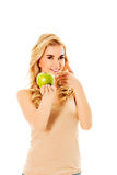 Young happy woman holding fresh green apple.  Royalty Free Stock Image