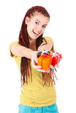 Young happy woman holding the gifts. Royalty Free Stock Image