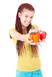 Young happy woman holding the gifts. Stock Photos