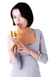 Young happy woman holding a glass of beer Royalty Free Stock Photography