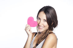 Young happy woman holding heart Stock Images