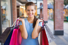 Young happy woman holding her shopping bags Royalty Free Stock Image