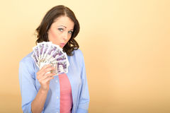 Young Happy Woman Holding Money Looking Pleased and Delighted Royalty Free Stock Photo