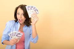 Young Happy Woman Holding Money Looking Pleased and Delighted Stock Images