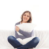 A young and happy woman holding a pillow Stock Photography
