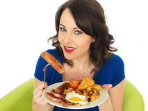 Young Happy Woman Holding a Plate of Full English Breakfast Stock Images