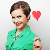 Young happy woman holding red  paper heart Royalty Free Stock Photos
