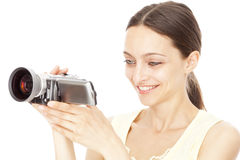 Young happy woman holding small video camera Stock Image