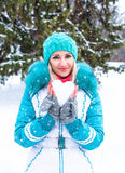 Young happy woman holding snow heart and enjoy in winter city park outdoor Royalty Free Stock Photos
