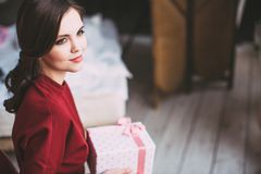 Young happy woman holding a stylish gift. Royalty Free Stock Photo