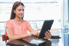 Young happy woman holding a tablet Stock Image