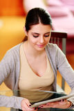 Young happy woman holding tablet computer Royalty Free Stock Image