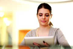 Young happy woman holding tablet computer Stock Photos