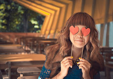 Young happy woman holding two hearts Stock Photography