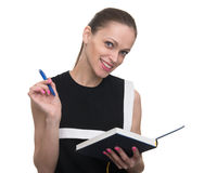 Young happy woman holds notepad and pen Stock Photos