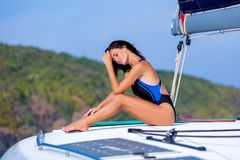 Young Happy Woman In Black Swimsuit Enjoying Evening Sun At Yacht Royalty Free Stock Photos
