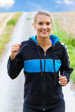 Young happy woman jogging Stock Photo