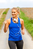 Young happy woman jogging Royalty Free Stock Images