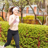 Young happy woman jogging in the street Stock Photo