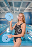 Young Happy Woman juggling with floating boards near swimming pool stock photos