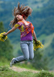 Young happy woman jumping Stock Photo